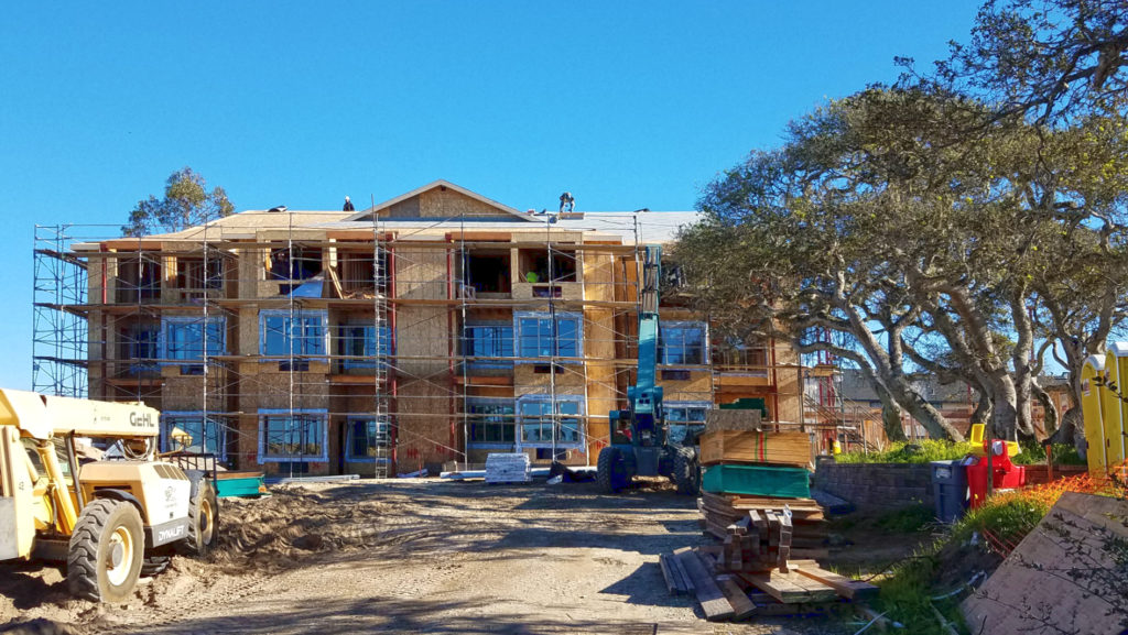 View of Junsay Oaks northeast wing, 3 stories in height, with windows in place.